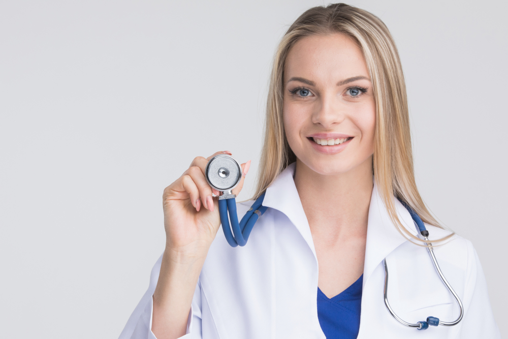 doctor female holding blue stethoscope