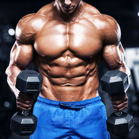 mh muscular man working out in gym with dumbbells