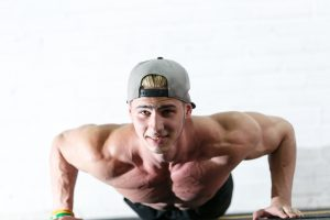 strong man doing pushups 300x200