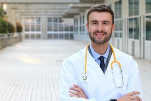 Doctor wearing white coat 300x200