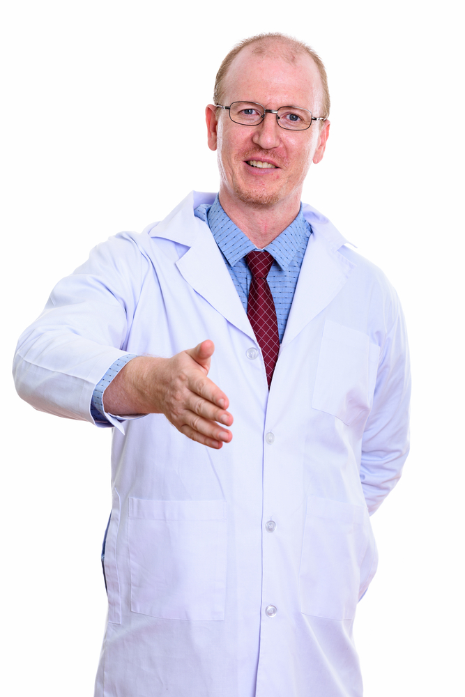 happy doctor prepared to shake hands
