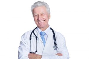 senior male doctor with arms crossed 300x200