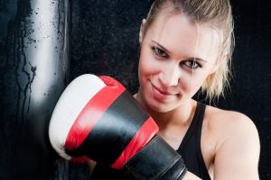 blond boxing training woman with gloves in gym SBI 300902506 300x200