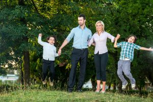 happy family having fun outdoors in the park_BYL0nLTBs 300x200